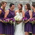 The Oaks Waterfront Inn & Events Maryland Wedding Venues bride with bridesmaids in purple dresses