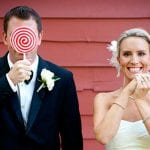 The Oaks Waterfront Inn & Events Maryland Wedding Venues happy newlywed couple with lollipops