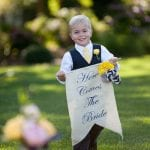 ring bearer at waterfront nautical themed wedding