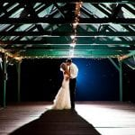 The Oaks Waterfront Inn & Events Maryland Wedding Venues newlyweds Kissing on our starlit dock