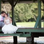 A private moment for bride and groom on the dock