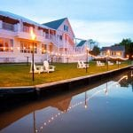 The Oaks Waterfront Inn & Events Maryland Wedding Venues waterfront lit with tiki torches