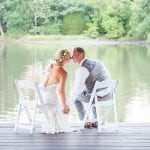 The Oaks Waterfront Inn & Events Maryland Wedding Venues newlyweds kissing while spending time on the waterfront dock