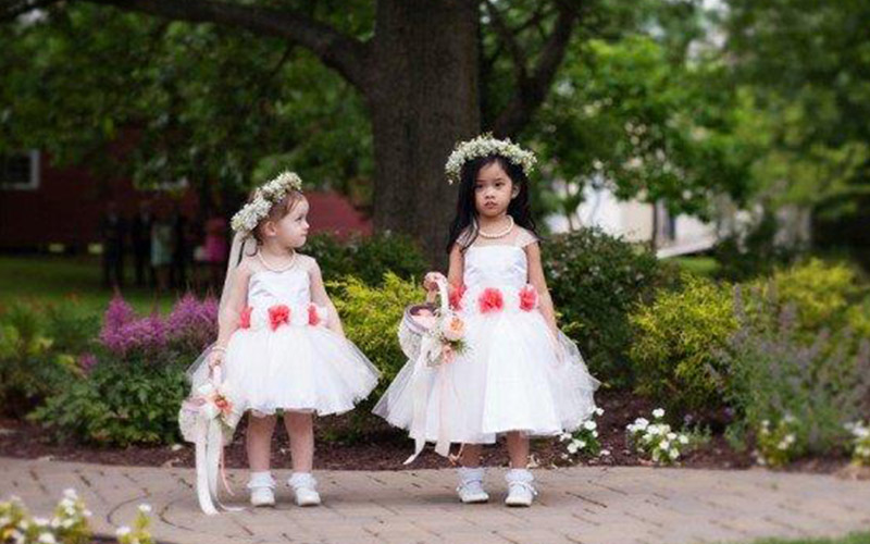 The Oaks Waterfront Inn & Events Maryland Wedding Venues flower girls walking on waterfront