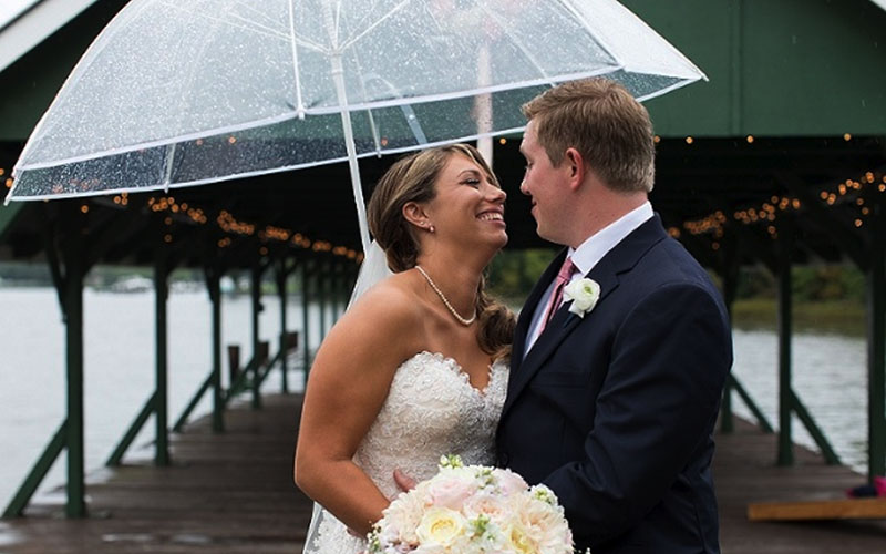The Oaks Waterfront Inn & Events Maryland Wedding Venues rainy day outdoor wedding