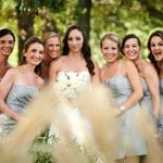 The Oaks Waterfront Inn & Events Maryland Wedding Venues bridal party through the reeds at waterfront wedding