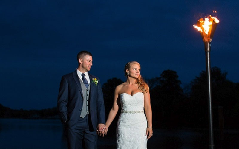 The Oaks Waterfront Inn & Events Maryland Wedding Venues newlywed couple outside waterfront at night
