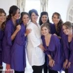 The Oaks Waterfront Inn & Events Maryland Wedding Venues bride in white with bridesmaids in purple prep for wedding reception