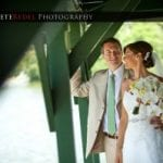 The Oaks Waterfront Inn & Events Maryland Wedding Venues newlyweds stare on the waterfront