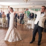 The Oaks Waterfront Inn & Events Maryland Wedding Venues newlywed couples dance on rustic wedding venue dance floor