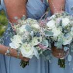 The Oaks Waterfront Inn & Events Maryland Wedding Venues bridesmaids floral arrangement