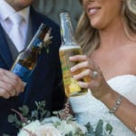 The Oaks Waterfront Inn & Events Maryland Wedding Venues newlyweds share a drink