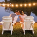 The Oaks Waterfront Inn & Events Maryland Wedding Venues newlywed couple kissing on the waterfront