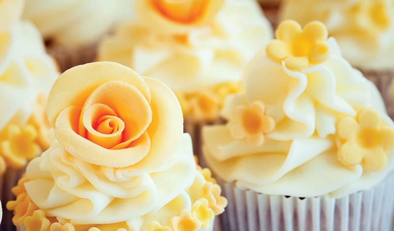 The Oaks Waterfront Inn & Events Maryland Wedding Venues yellow wedding cupcakes