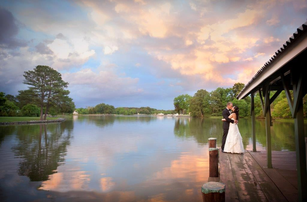 The Oaks Waterfront Inn & Events Maryland Wedding Venues newlyweds kissing on dock under twilight