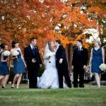 The Oaks Waterfront Inn & Events Maryland Wedding Venues newlyweds kissing in rustic fall wedding