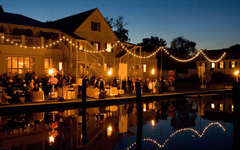 The Oaks Waterfront Inn & Events Maryland Wedding Venues nighttime wedding reception on waterfront
