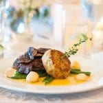 The Oaks Waterfront Inn & Events Maryland Wedding Venues steak and cake platter