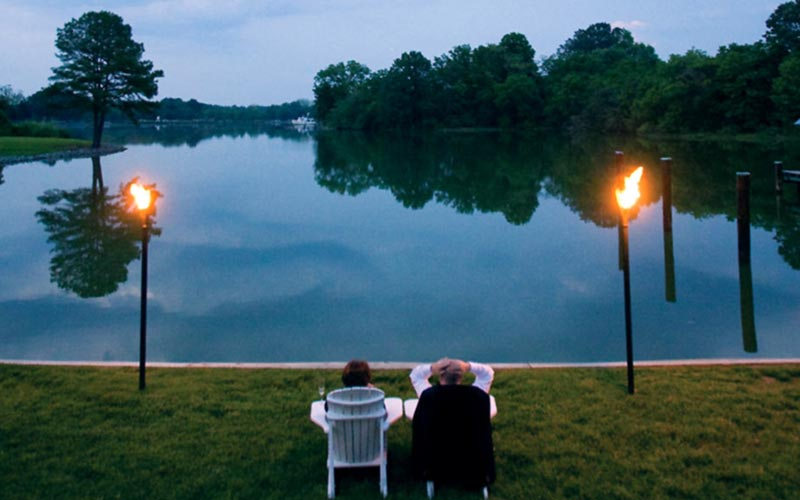 The Oaks Waterfront Inn & Events Maryland Wedding Venues waterfront views with tiki lights