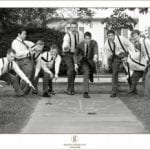 The Oaks Waterfront Inn & Events Maryland Wedding Venues groomsmen playing shuffleboard
