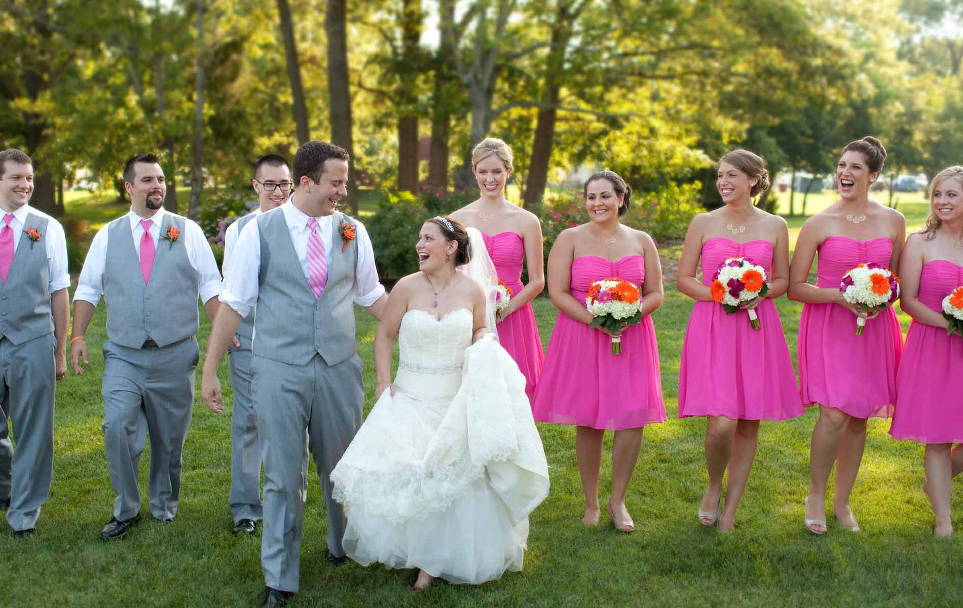 The Oaks Waterfront Inn & Events Maryland Wedding Venues bride and groom walk with bridesmaids and groomsmen on waterfront