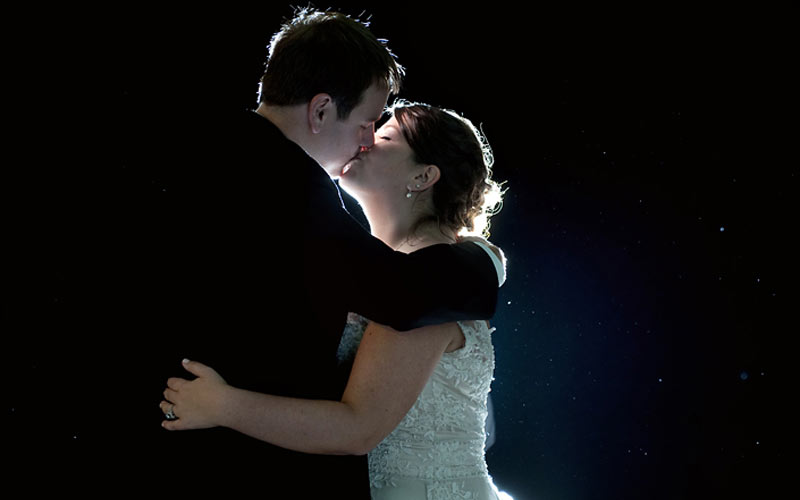 The Oaks Waterfront Inn & Events Maryland Wedding Venues newlyweds kissing under the stars