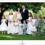 The Oaks Waterfront Inn & Events Maryland Wedding Venues family wedding photo under the trees