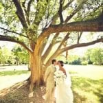 The Oaks Waterfront Inn & Events Maryland Wedding Venues newlyweds kissing under the trees at the oaks