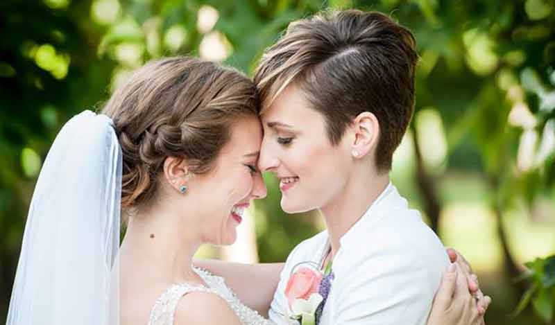 The Oaks Waterfront Inn & Events Maryland Wedding Venues gay newlyweds