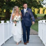 The Oaks Waterfront Inn & Events Maryland Wedding Venues newlyweds take a walk