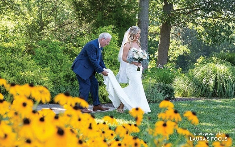 The Oaks Waterfront Inn & Events Maryland Wedding Venues fathers hold brides train