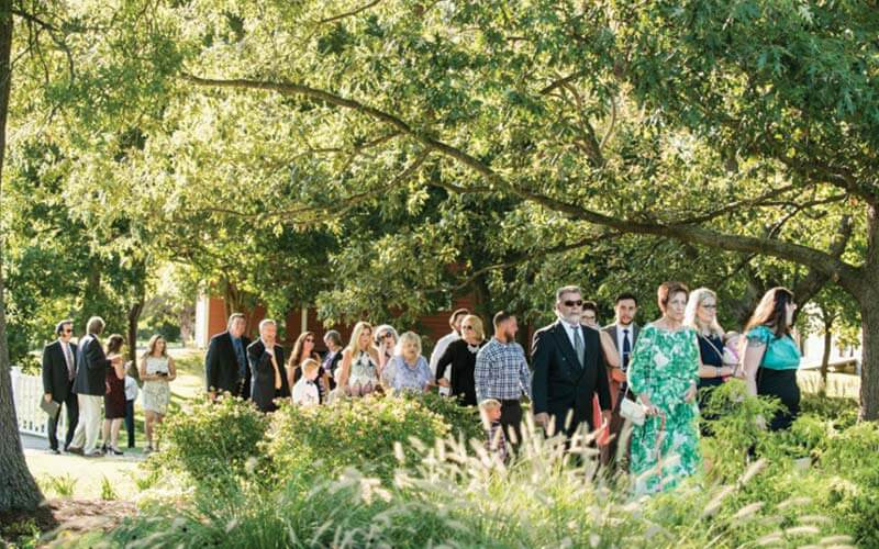 The Oaks Waterfront Inn & Events Maryland Wedding Venues family and wedding guests arrive to wedding reception